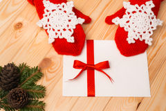 Woman in red knitted mittens keeps a Christmas letter Stock Image