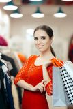 Woman in Red Lace Dress Shopping for Clothes Stock Photos