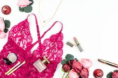 Woman red lace lingerie, flowers, make up items on white background. Postcard for Womens Day. Stock Photography