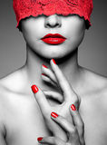 Woman with red lacy ribbon on eyes. Portrait of young beautiful woman with red lacy ribbon on eyes stock photos