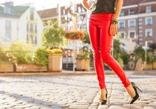 Woman in red leather trousers royalty free stock photos