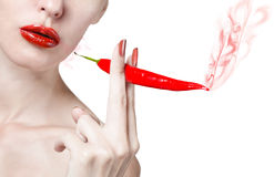 Woman with red lips. Portrait of the woman with red lips and red burning pepper Royalty Free Stock Photography