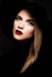 Woman with red lips. And black hat Stock Photo