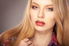 Woman red lips. Blonde beautiful woman with bright red lips Royalty Free Stock Photos