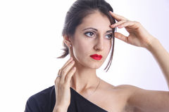 Woman with red lips and brown eyes touching her face. Wellness and cosmetic. woman with red lips and brown eyes. studio shot Stock Image