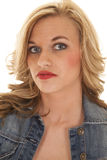 Woman red lips denim jacket serious Royalty Free Stock Image