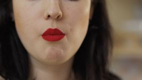Woman with red lips eats cucumber. Beautiful woman with red lips eats fresh cucumber. Pretty female enjoys fresh vegetables. Prores codec stock video