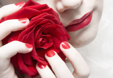 Woman with red lips, nails and rose