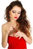 Woman with red lips paint your nails Royalty Free Stock Images