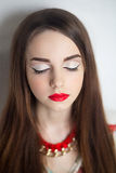 Woman with red lips. Portrait of beautiful young girl, woman, lady, model. Flawless makeup, perfect shape of  eyebrows, long eyelashes, best bright red lipstick Royalty Free Stock Photography