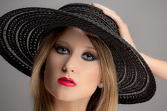 Woman With Red Lips and Smokey Eyes Royalty Free Stock Images