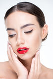 Woman with red lips touching face Royalty Free Stock Photos