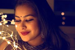 Woman With Red Lipstick And Black Bindi Stock Photography