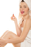 Woman with red lipstick licking her lips Stock Image