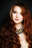 Woman with Red Long Hair Stock Photo