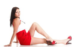 Woman in red lying down on the floor  Stock Images