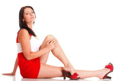 Woman in red lying down on the floor isolated Royalty Free Stock Image