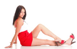 Woman in red lying down on the floor isolated Stock Images