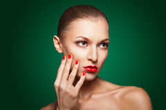 Woman with red make-up and manicure over green Stock Photography