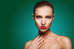 Woman with red make-up and manicure over green Royalty Free Stock Photography