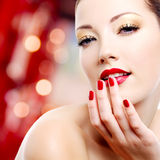 Woman with red manicure Royalty Free Stock Photography