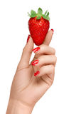 Woman with Red Manicured Nails Holding a Strawberry Stock Image