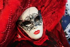 Woman in red. Red woman in mask during Venice Carnival stock photo