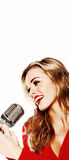 Woman In Red With Microphone Royalty Free Stock Photography