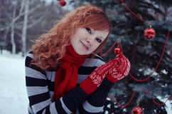 Woman in red mittens Stock Images