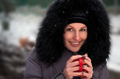 Woman with a red mug of coffee Royalty Free Stock Images