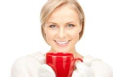 Woman with red mug Stock Photography
