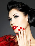 Woman with red nails and creative hairstyle Royalty Free Stock Photos