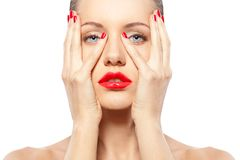 Woman with red nails and lips Royalty Free Stock Image