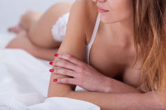 Woman with red nails is in white lingerie Stock Photography