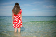 Woman in red near the sea Royalty Free Stock Images