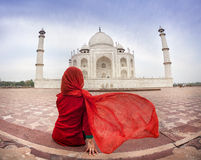 Woman in red near Taj Mahal Stock Images