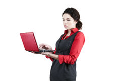 Woman with red netbook. Woman in red with red netbook royalty free stock images