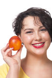 Woman with red orange. Portrait of a smiling woman holding red orange Royalty Free Stock Image