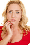 Woman red outfit close hand chin serious Stock Photos