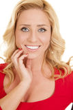 Woman red outfit close hand chin smile Royalty Free Stock Images