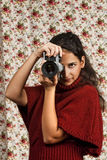 Woman in red over floral background. Woman in red over colorful floral background Royalty Free Stock Photo