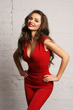 Woman in red overall Stock Photo