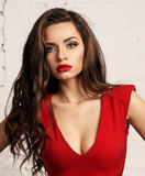 Woman in red overall Stock Image