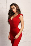 Woman in red overall Stock Images