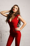 Woman in red overall Royalty Free Stock Photo