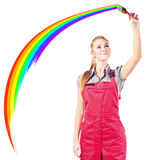 Woman in red overalls with painting brush Stock Photography