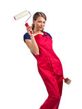 Woman in red overalls with painting tools Royalty Free Stock Images