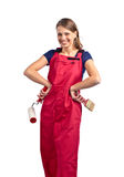 Woman in red overalls with painting tools Stock Photos