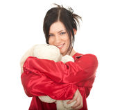 Woman in red pajamas with teddy bear Royalty Free Stock Photography
