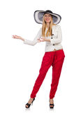 Woman in red pants and hat isolated on white Stock Photo